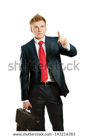 A young man pointing something isolated on white background
