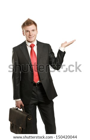 A young man pointing something isolated on white background - stock photo