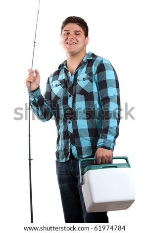 A young man poses with his fishing reel and beer cooler isolated over white in studio with negative space. - stock photo