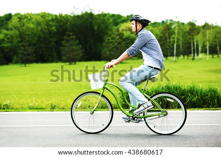 a young man riding a bicycle in a park