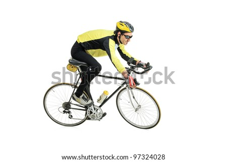 A young man riding a bicycle isolated against white background