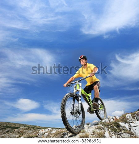 A young man riding a mountain bike outdoor