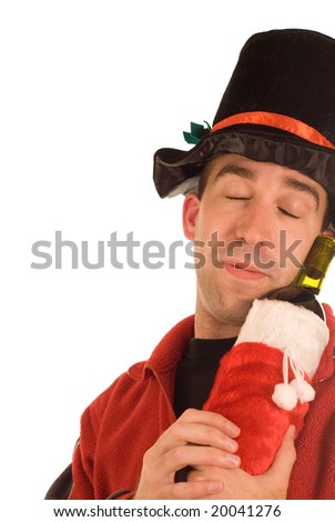 A young man snuggling with his booze, isolated against a white background - stock photo