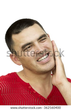 A young man suffering from a toothache, Asian man and toothache Portrait of a young man with a toothache, Unhappy Asian man with a toothache - stock photo