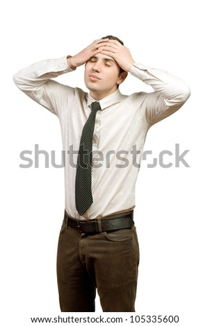 a young man suffering from headache - stock photo