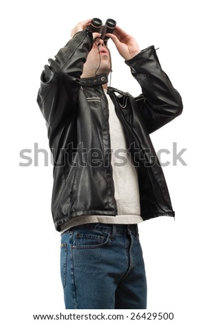 A young man using a pair of binoculars to do some bird watching, isolated against a white background - stock photo