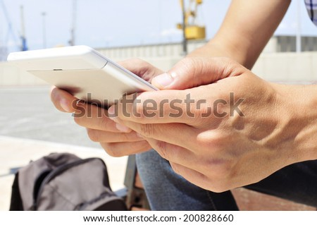 a young man using a tablet or an e-book - stock photo