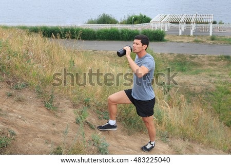A young man walking on the trail. travel sport lifestyle concept. Young athlete drinking fresh water.