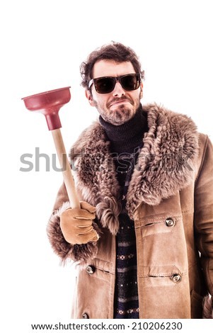 a young man wearing a sheepskin coat isolated over a white background holding a plunger - stock photo