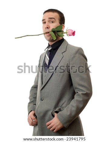 A young man wearing a suit holding a single rose in his mouth, isolated against a white background