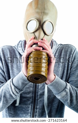 A young man wears a gas mask isolated over a white background. - stock photo