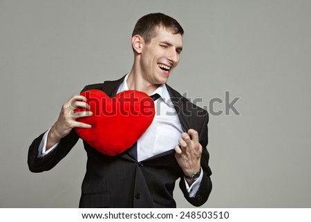 a young man with a red heart - stock photo