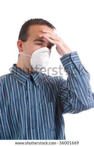 A young man with a respiratory infection is wearing a mask to protect others and is suffering from a headache, isolated against a white background - stock photo