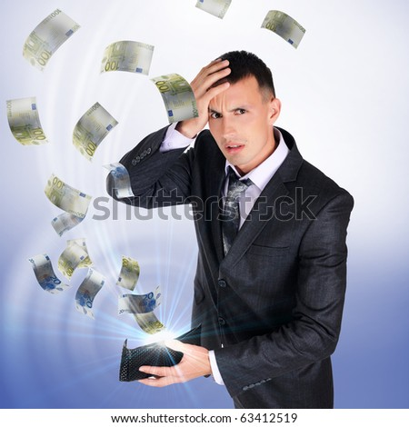 A young man with a wallet from which cash flow ejected - stock photo