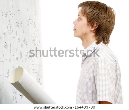 A young man with blueprints near a scheme, isolated on a white background - stock photo