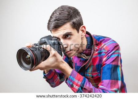 A young man with camera