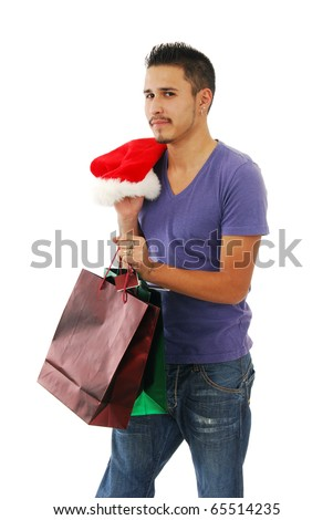 A young man with Christmas shopping bags and a Santa hat