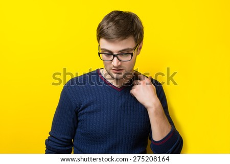 a young man with glasses - stock photo