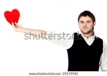 A young man with his big scarlet heart in his outstretched  hand