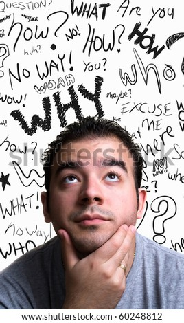 A young man with his hand on his chin looks like he is thinks deeply about something. Doodle question words floating in the background. - stock photo