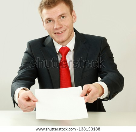A young man working with papers, isolated on white background - stock photo
