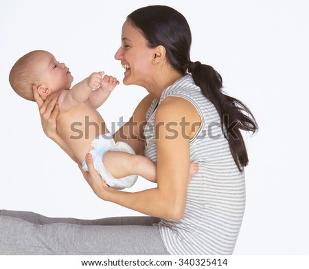 A young mother and baby - stock photo