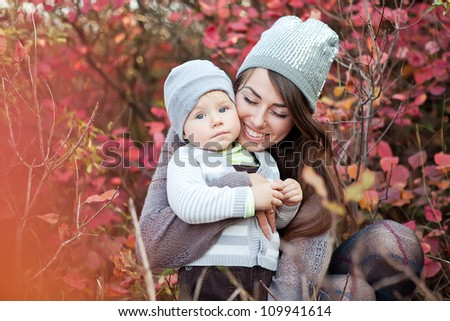 A young mother and her baby fall fun - stock photo