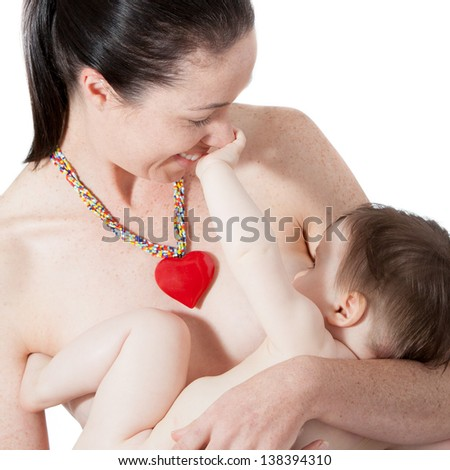 A young mother holds her breast feeding baby - stock photo