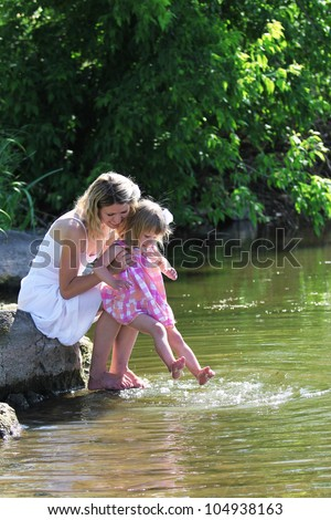 a young mother with her daughter on the nature