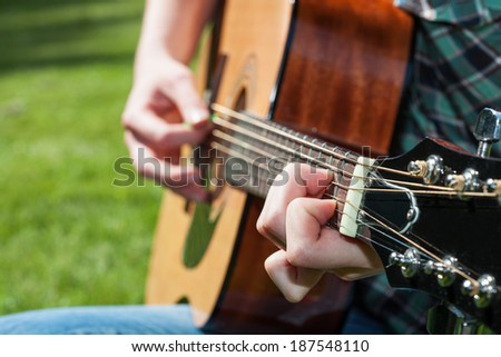 A young music artist playing the classic guitar - stock photo
