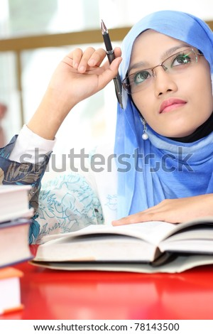 A young muslim girl was thinking - stock photo
