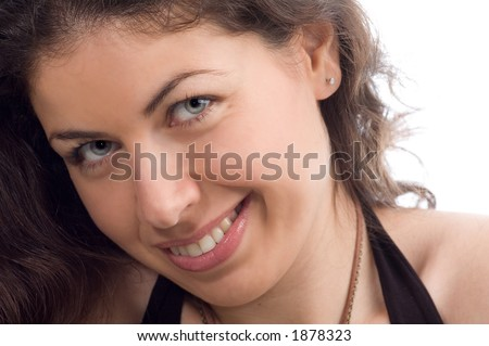 A young natural woman smiling sideways
