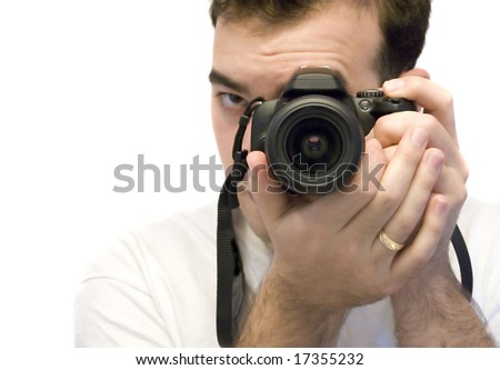 A young photographer taking a shot with his DSLR camera