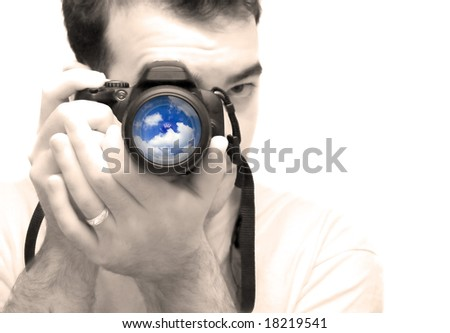 A young photographer taking a shot with his DSLR camera.  Selective color and shallow depth of field. - stock photo