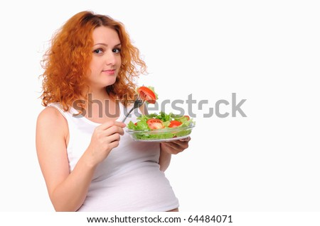 A young pregnant woman chooses a healthy natural food