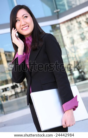 A young, pretty asian woman business woman at the office