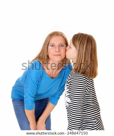A young pretty girl kissing her mom on the chick, isolated for white background.  - stock photo