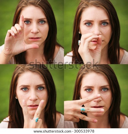 a young pretty girl making the symbols that spell out love with her fingers in front of her face  - stock photo