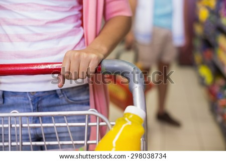 A young pretty woman buying a products in supermarket