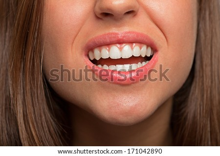 A young pretty woman teeth extreme closeup photo - stock photo