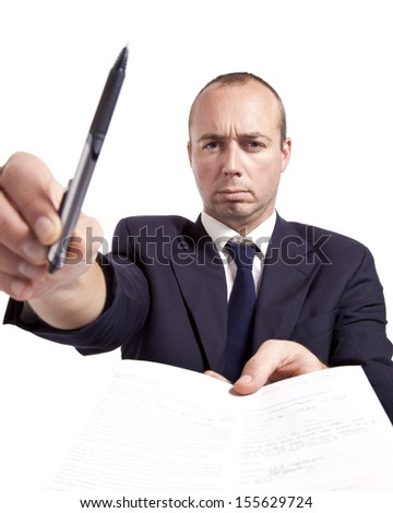 A young professional man holds up a pen and handing you something to sign.