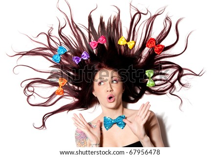 a young redhead wearing a bunch of colorful bows - stock photo