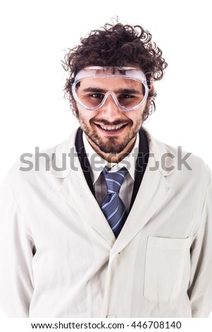 a young researcher in lab coat and protective glasses portrait isolated over a white background - stock photo