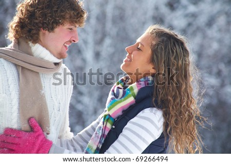 A young romance couple wants to kiss in Winter Park