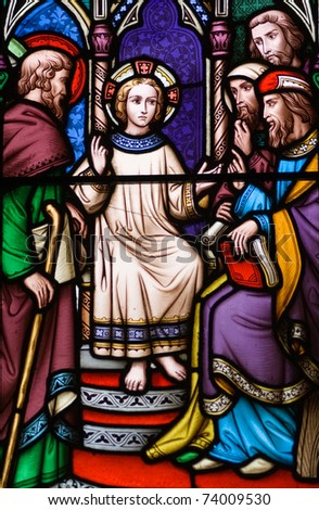 A young saint depicted on a Victorian Stained Glass window.