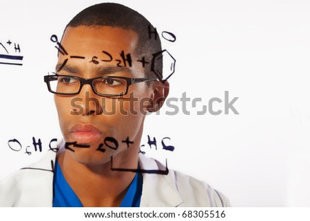 A young scientist works on a chemistry problem - stock photo