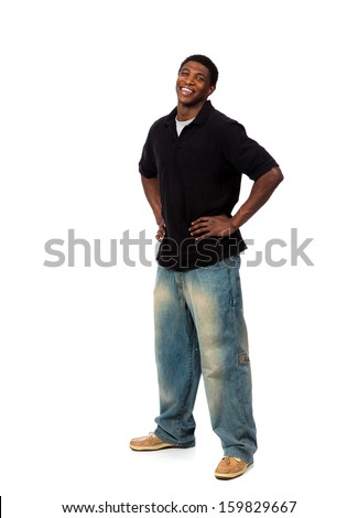 A young smiling casually dressed African American male standing on a white background