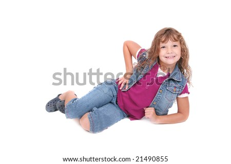 a young smiling child with funny attitude laying down over white
