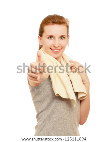 A young sportive girl with towel showing ok, isolated on white background