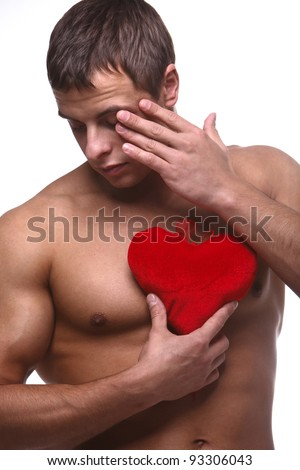 A young strong muscular man with red valentine heart